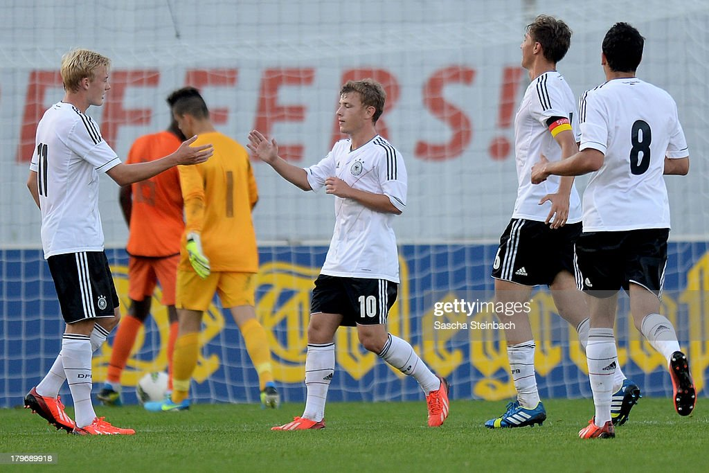 Julian Brandt (L) of Germany celebrates with team mates after scoring their third goal during the U19 international friendly match between The Netherlands and Germany on September 6, 2013 in Nijmegen, Netherlands.