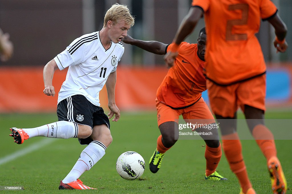 Julian Brandt (L) of Germany competes for the ball with Moussa Sanoh (R) of The Netherlands during the U19 international friendly match between The Netherlands and Germany on September 6, 2013 in Nijmegen, Netherlands.