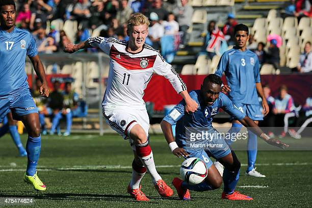 Julian Brandt of Germany controls the ball from Mohammed Khan of Fiji during the Group E Group E FIFA U20 World Cup New Zealand 2015 match between...