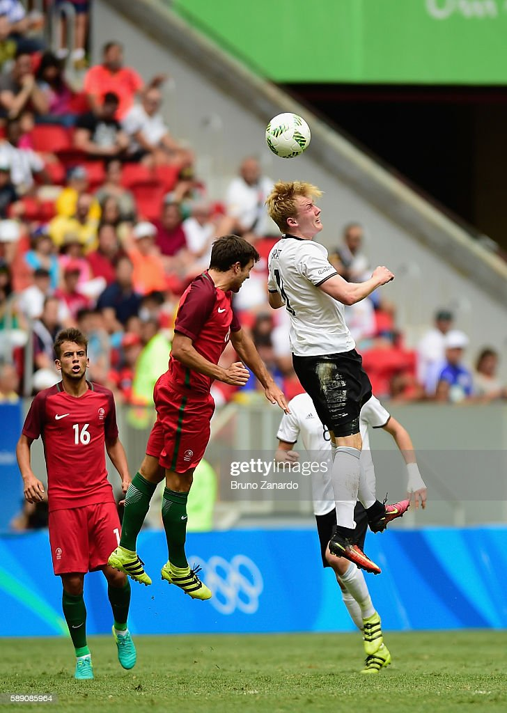 Julian Brandt of Germany goes up for a headball against Portugal during the second half of the Men's Football Quarterfinal match on Day 8 of the Rio...