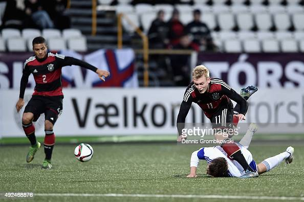 Julian Brandt of Germany is challenged by Gestur Dam of Faroe Islands during the 2017 UEFA European U21 Championships Qualifier between U21 Faroe...