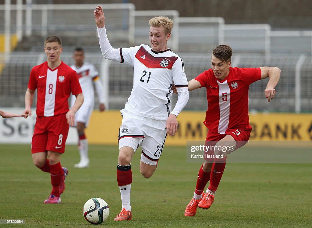 Julian Brandt of Germany is challenged by Igor Lasicki of Poland during the International Friendly match between U20 Germany and U20 Poland at...