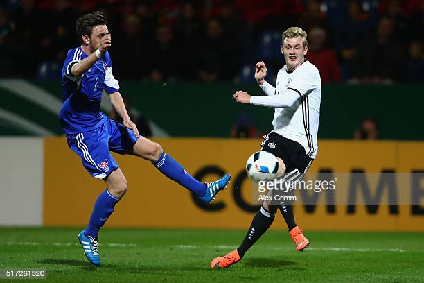 Julian Brandt of Germany is challenged by Leivur Joensen of Faroe Islands during the 2017 UEFA European U21 Championships qualifier match between...