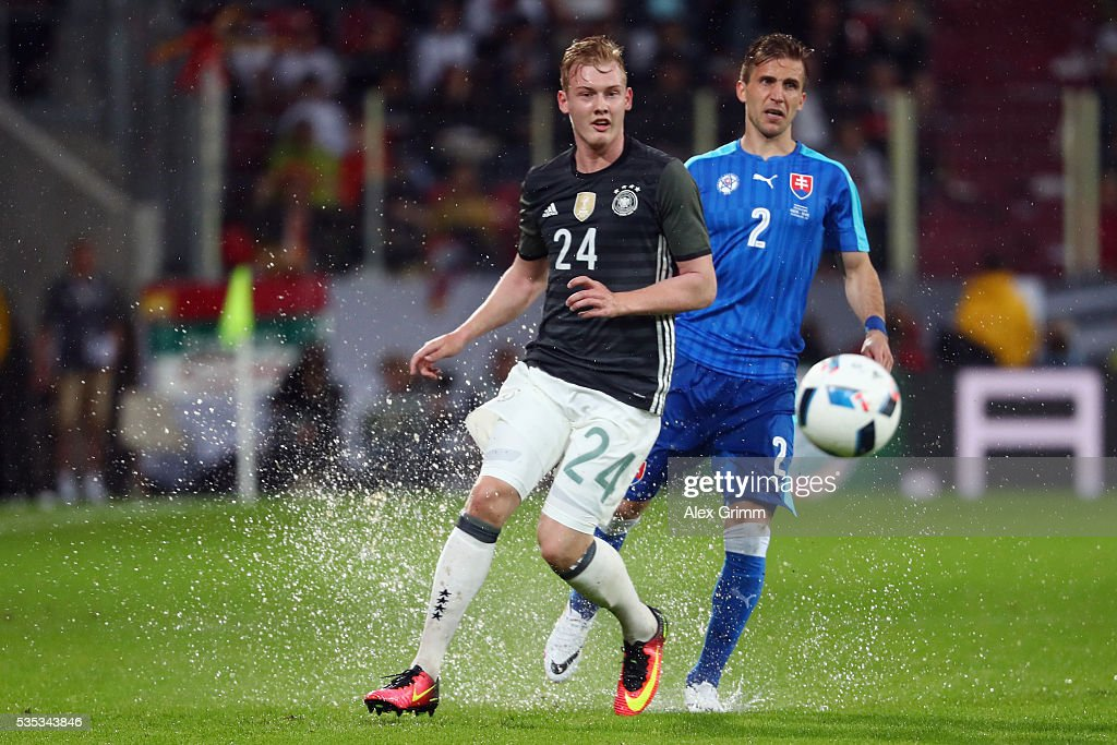 <a gi-track='captionPersonalityLinkClicked' href=/galleries/search?phrase=Julian+Brandt&family=editorial&specificpeople=7840042 ng-click='$event.stopPropagation()'>Julian Brandt</a> (L) of Germany is challenged by <a gi-track='captionPersonalityLinkClicked' href=/galleries/search?phrase=Peter+Pekarik&family=editorial&specificpeople=5577121 ng-click='$event.stopPropagation()'>Peter Pekarik</a> of Slovakia during the international friendly match between Germany and Slovakia at WWK-Arena on May 29, 2016 in Augsburg, Germany.