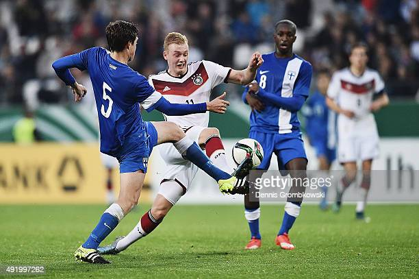 Julian Brandt of Germany is challenged by Sauli Vaisanen of Finland during the 2017 UEFA European U21 Championships Qualifier between U21 Germany and...