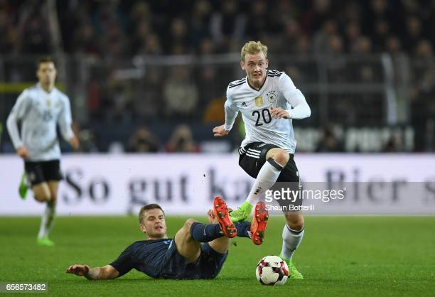 Julian Brandt of Germany is tackled by Eric Dier of England during the international friendly match between Germany and England at Signal Iduna Park...