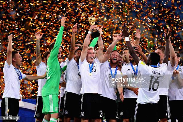Julian Brandt of Germany lifts the FIFA Confederations Cup trophy after the FIFA Confederations Cup Russia 2017 Final match between Chile and Germany...