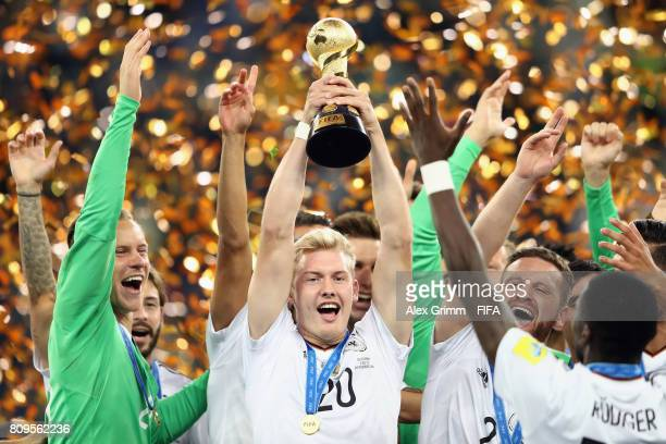 Julian Brandt of Germany lifts the FIFA Confederations Cup trophy after the FIFA Confederations Cup Russia 2017 final between Chile and Germany at...