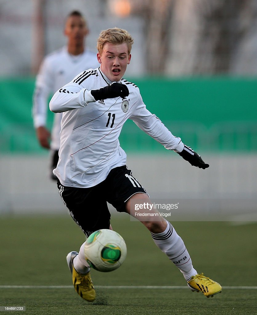 Julian Brandt of Germany runs with the ball during the UEFA Under17 Elite Round match between Germany and Bulgaria at Toennies-Arena on March 26, 2013 in Rheda-Wiedenbruck, Germany.