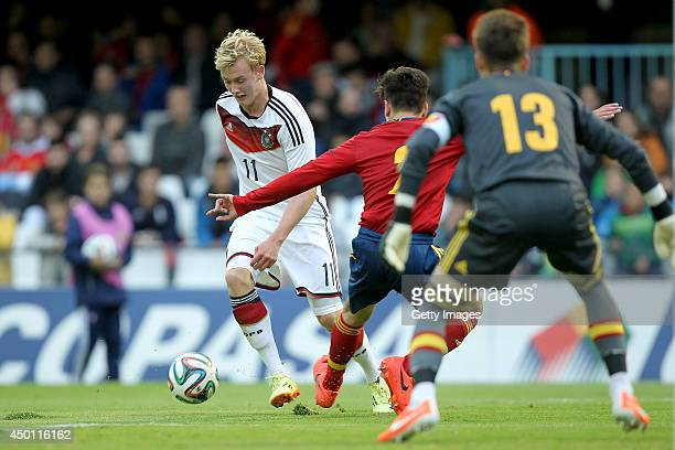 Julian Brandt of Germany scores his team's second goal past goalkeeper Ruben Blanco and Hector Bellerin of Spain during the UEFA Under 19 Elite Round...