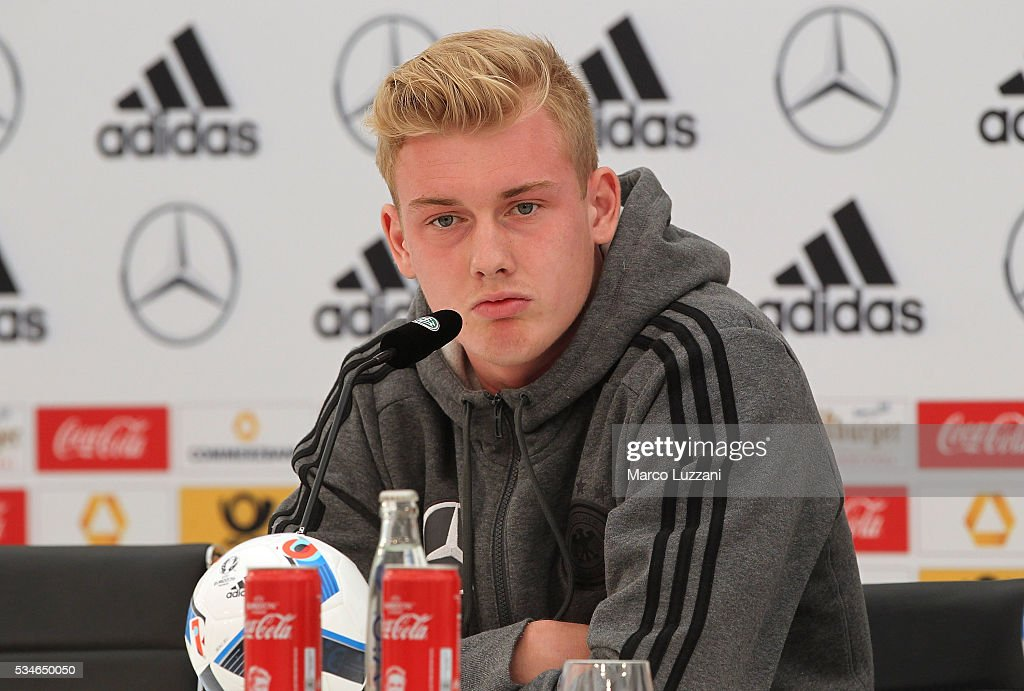 <a gi-track='captionPersonalityLinkClicked' href=/galleries/search?phrase=Julian+Brandt&family=editorial&specificpeople=7840042 ng-click='$event.stopPropagation()'>Julian Brandt</a> of Germany speaks to the media during a press conference at the German national team's pre-EURO 2016 training camp on May 27, 2016 in Ascona, Switzerland.