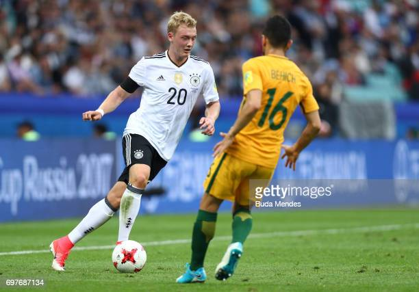 Julian Brandt of Germny attempts to take the ball past Aziz Behich of Australia during the FIFA Confederations Cup Russia 2017 Group B match between...