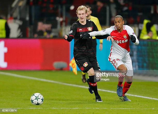 Julian Brandt of Leverkusen and Abdou Diallo of Monaco battle for the ball during the UEFA Champions League match between Bayer Leverkusen and AS...