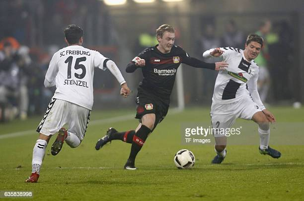 Julian Brandt of Leverkusen and Alexandar Ignjovski of Freiburg and Pascal Stenzel battle for the ball during the Bundesliga match between Bayer 04...