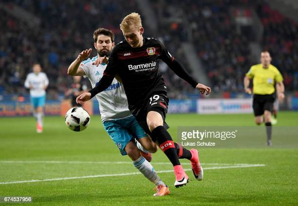 Julian Brandt of Leverkusen and Coke of Schalke battle for the ball during the Bundesliga match between Bayer 04 Leverkusen and FC Schalke 04 at...