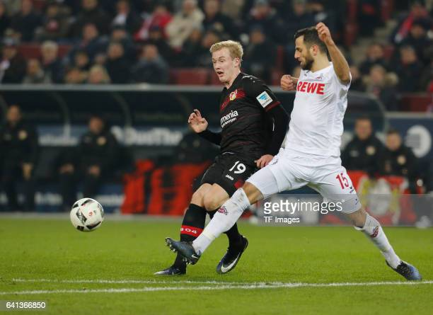 Julian Brandt of Leverkusen and Mergim Mavraj of Cologne battle for the ball during the Bundesliga soccer match between 1 FC Cologne and Bayer...