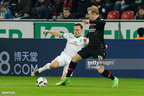 Julian Brandt of Leverkusen and Robert Bauer of Werder Bremen battle for the ball during the Bundesliga soccer match between Bayer Leverkusen and...
