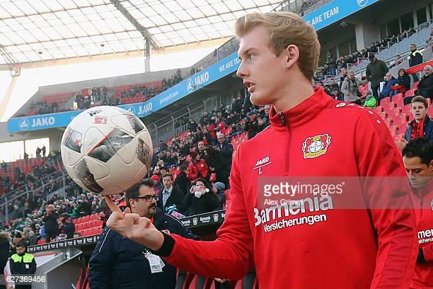 Julian Brandt of Leverkusen balances the ball on his finger prior to the Bundesliga match between Bayer 04 Leverkusen and SC Freiburg at BayArena on...