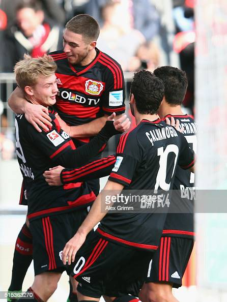 Julian Brandt of Leverkusen celebrates his team's first goal with team mates during the Bundesliga match between Bayer 04 Leverkusen and Hamburger SV...