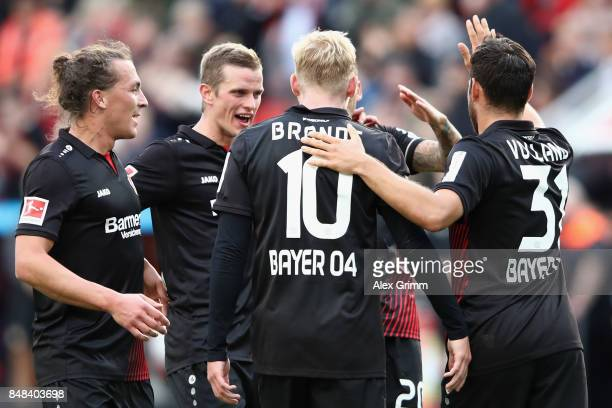 Julian Brandt of Leverkusen celebrates his team's fourth goal with team mates Julian Baumgartlinger Sven Bender and Kevin Volland during the...