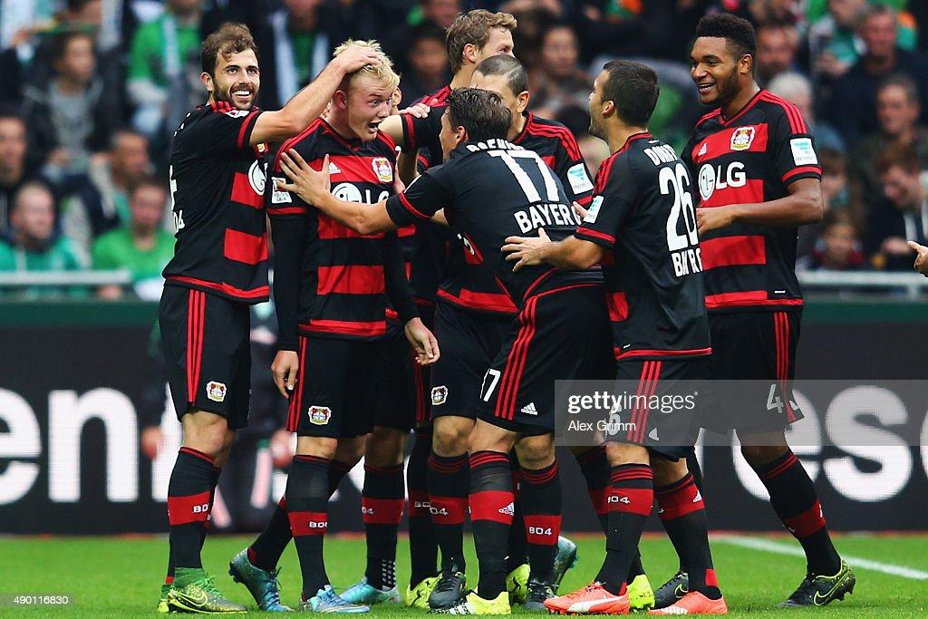 Julian Brandt of Leverkusen celebrates his team's second goal with team mates during the Bundesliga match between Werder Bremen and Bayer Leverkusen...
