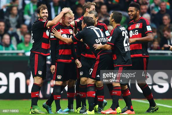 Julian Brandt of Leverkusen celebrates his team's second goal with team mates during the Bundesliga match between Werder Bremen and Bayer Leverkusen...