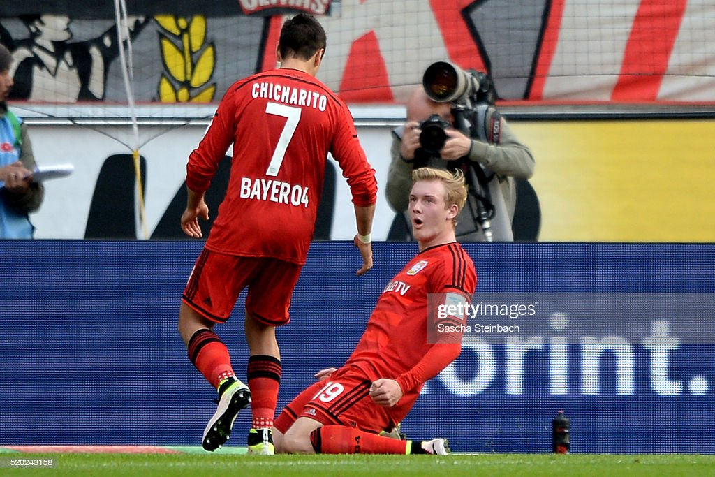 Julian Brandt (R) of Leverkusen celebrates with team mate Chicharito after scoring the opening goal during the Bundesliga match between 1. FC Koeln and Bayer Leverkusen at RheinEnergieStadion on April 10, 2016 in Cologne, Germany.