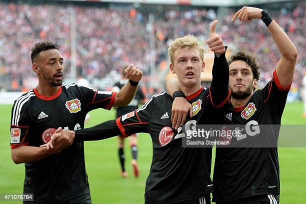 Julian Brandt of Leverkusen celebrates with team mates after scoring the opening goal during the Bundesliga match between 1 FC Koeln and Bayer 04...