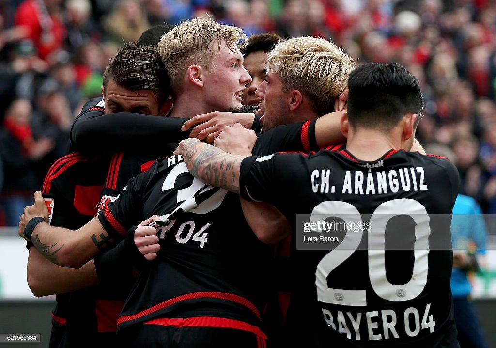 Julian Brandt of Leverkusen celebrates with team mates after scoring his teams second goal during the Bundesliga match between Bayer Leverkusen and...