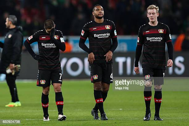 Julian Brandt of Leverkusen Jonathan Tah and Chicharito react after the Bundesliga match between Bayer 04 Leverkusen and Borussia Moenchengladbach at...
