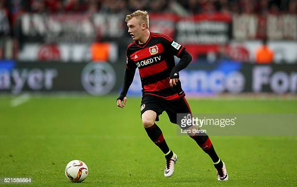 Julian Brandt of Leverkusen runs with the ball during the Bundesliga match between Bayer Leverkusen and Eintracht Frankfurt at BayArena on April 16...