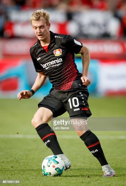Julian Brandt of Leverkusen runs with the ball during the Bundesliga match between Bayer 04 Leverkusen and VfL Wolfsburg at BayArena on October 15...