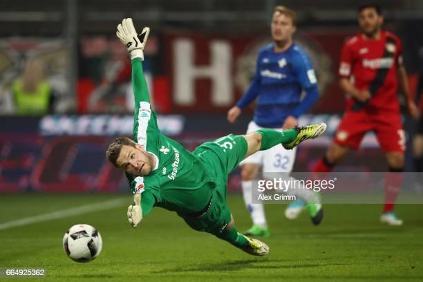 Julian Brandt of Leverkusen scores his team's first goal past goalkeeper Michael Esser of Darmstadt during the Bundesliga match between SV Darmstadt...