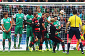 Julian Brandt of Leverkusen scores his team's second goal with a freekick during the Bundesliga match between Werder Bremen and Bayer Leverkusen at...