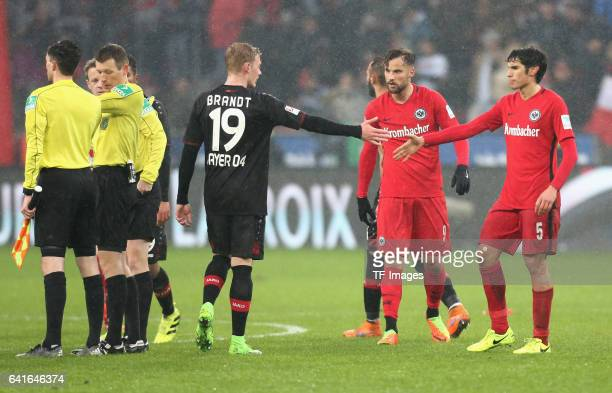 Julian Brandt of Leverkusen shakes hands with Jesus Vallejo of Eintracht Frankfurt und Haris Seferovic during the Bundesliga match between Bayer 04...