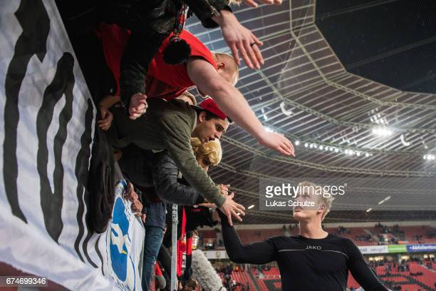 Julian Brandt of Leverkusen talks to the fans after the Bundesliga match between Bayer 04 Leverkusen and FC Schalke 04 at BayArena on April 28 2017...