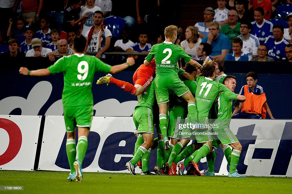 Julian Brandt of Wolfsburg celebrates with teammates after scoring his team's first goal during the A Juniors Championships semifinal second leg match between Schalke 04 and VfL Wolfsburg at Veltins-Arena on June 18, 2013 in Gelsenkirchen, Germany.