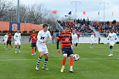 Julian Buescher of the Syracuse Orange controls the ball as Tyler Dowse of the Dartmouth Big Green defends during the first half at the SU Soccer...