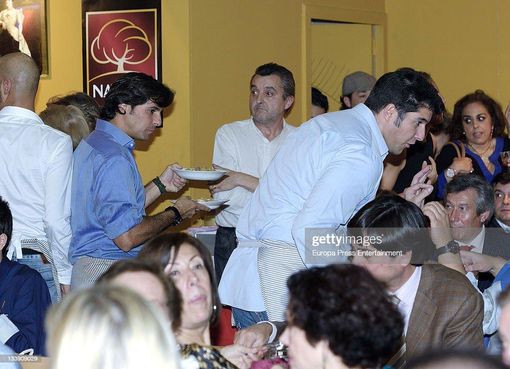 Julian Contreras (L) and Francisco Rivera (R) as waiters during 'Rastrillo Nuevo Futuro' at La Pipa in Casa de Campo on November 21, 2011 in Madrid, Spain.