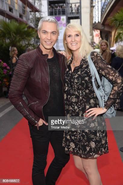 Julian David and Anika Reichel attend the Riani Fashion Show Spring/Summer 2018 at Umspannwerk Kreuzberg on July 4 2017 in Berlin Germany