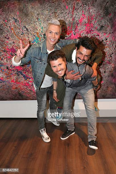 Julian David artist Reza Nassrollahi and Thore Schoelermann during the Rezalution pop up store and art gallery opening on April 26 2016 in Munich...