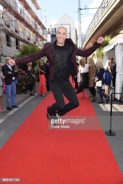 Julian David attends the Riani Fashion Show Spring/Summer 2018 at Umspannwerk Kreuzberg on July 4 2017 in Berlin Germany