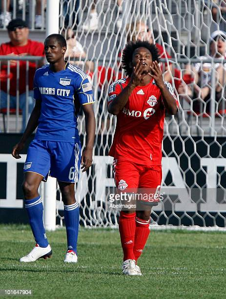Julian de Guzman of Toronto FC reacts to a missed open net in front of Pablo Escobar of the Kansas City Wizards during a MLS game at BMO Field June 5...