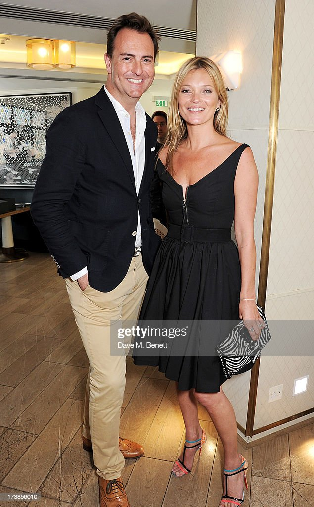 Julian Diment (L) and Kate Moss attend a first look at a new range of tech accessories for Carphone Warehouse, designed exclusively by Kate Moss for the high street brand, at The Club at The Ivy on July 18, 2013 in London England. The range of smartphone and tablet accessories goes on sale nationwide later this month.