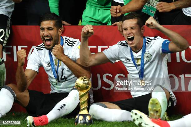 Julian Draxler and Emre Can of Germany celebrate with the trophy at the end of the FIFA Confederations Cup Russia 2017 Final match between Chile and...