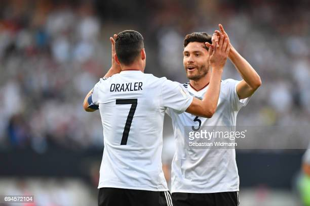 Julian Draxler and Jonas Hector of Germany celebrate the first goal for their team during the FIFA 2018 World Cup Qualifier between Germany and San...
