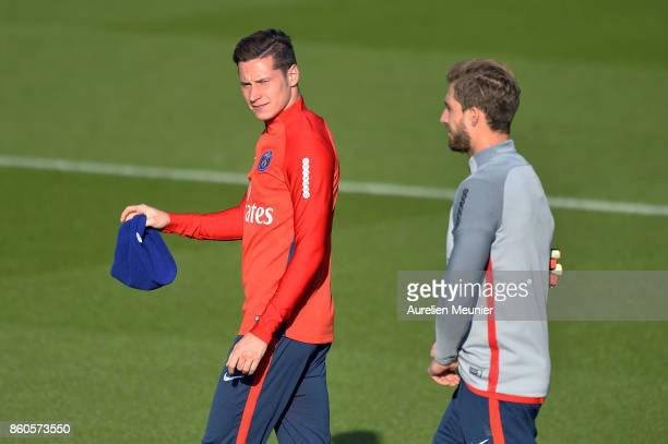 Julian Draxler and Kevin Trapp of Paris SaintGermain react as he arrives for a Paris SaintGermain training session at Centre Ooredoo on October 12...