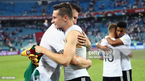 Julian Draxler and Niklas Suele of Germany embrace after the FIFA Confederations Cup Russia 2017 Group B match between Germany and Cameroon at Fisht...