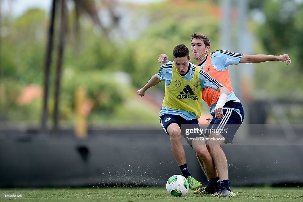 <a gi-track='captionPersonalityLinkClicked' href=/galleries/search?phrase=Julian+Draxler&family=editorial&specificpeople=7184479 ng-click='$event.stopPropagation()'>Julian Draxler</a> and <a gi-track='captionPersonalityLinkClicked' href=/galleries/search?phrase=Stefan+Reinartz&family=editorial&specificpeople=2244849 ng-click='$event.stopPropagation()'>Stefan Reinartz</a> battle for the ball during a training session at Barry University on May 27, 2013 in Miami, Florida.