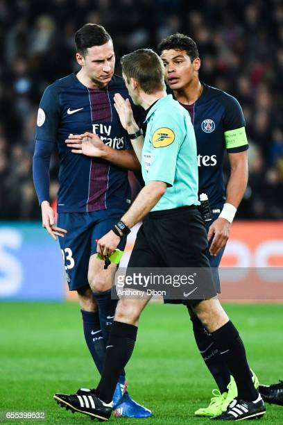 Julian Draxler and Thiago Silva of PSG talks with referee Clement Turpin during the French Ligue 1 match between Paris Saint Germain and Lyon at Parc...